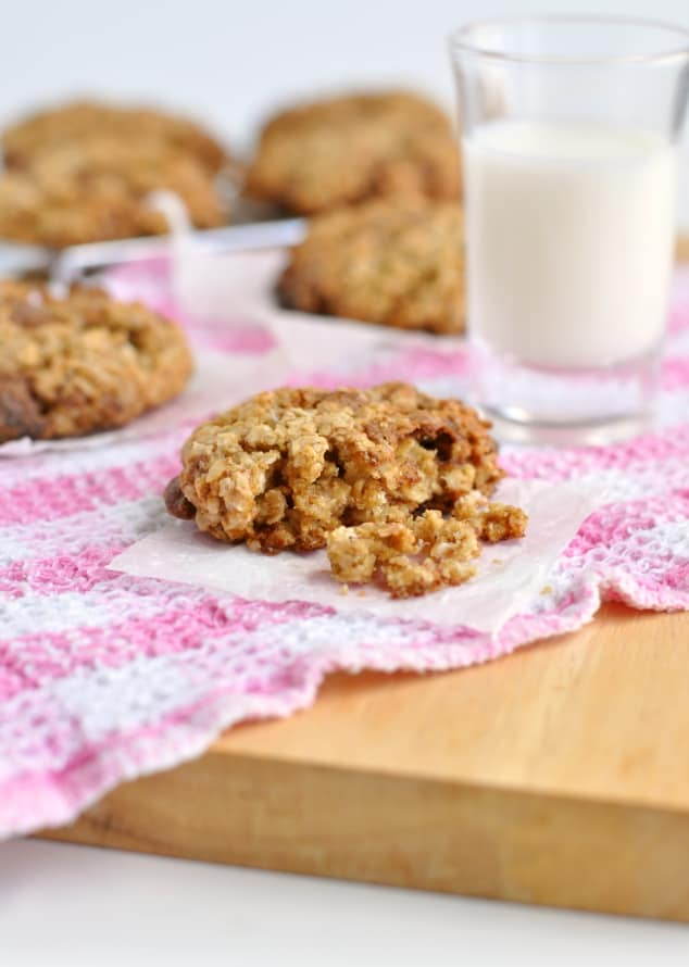 A half-eaten healthy chocolate chip oatmeal cookie
