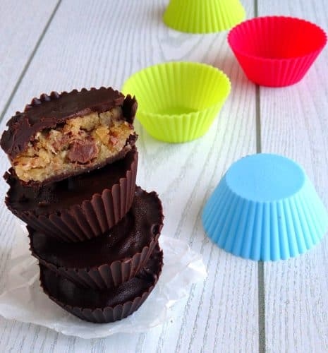 Healthy Peanut Butter Chocolate Chip Cookie Dough Cups Recipe - just because you're trying to be healthy doesn't mean you can't have awesome snacks! These delicious dark chocolate cups are stuffed full of the most amazing (and vegan, and gluten-free, and HEALTHY!) chocolate chip peanut butter cookie dough!