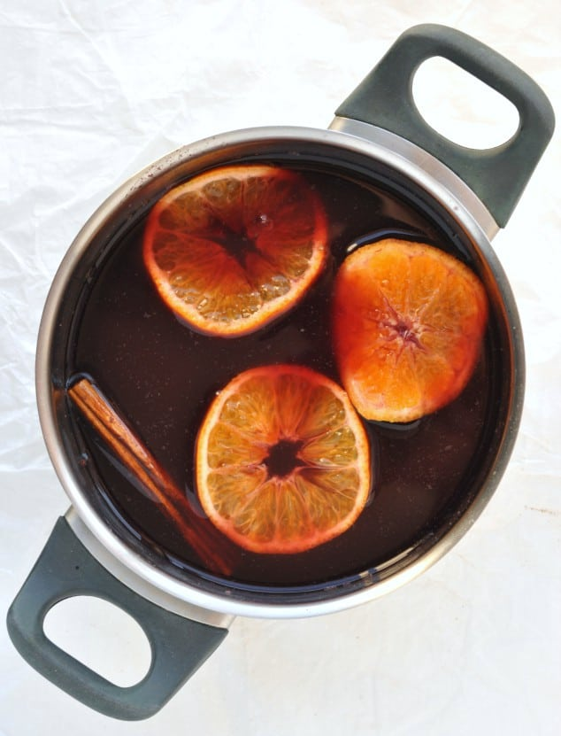 Overhead shot of a saucepan filled with mulled wine ingredients