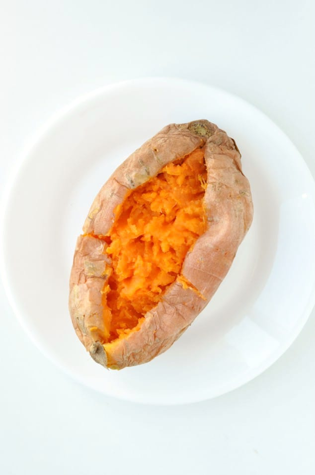 Healthy baked sweet potato with bright orange insides