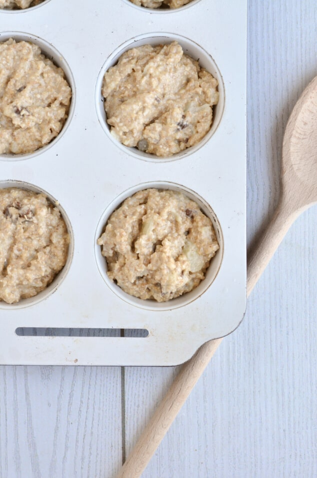 Batter for Healthy Oat Bran Muffins with Chocolate Chips in a muffin tin