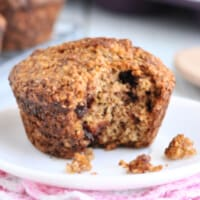 A Healthy Oat Bran Muffin with Chocolate Chips with a bite taken out