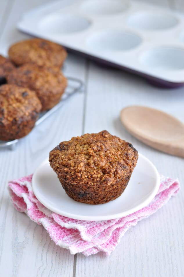 Healthy Oat Bran Muffin with Chocolate Chips on a plate on a pink napkin