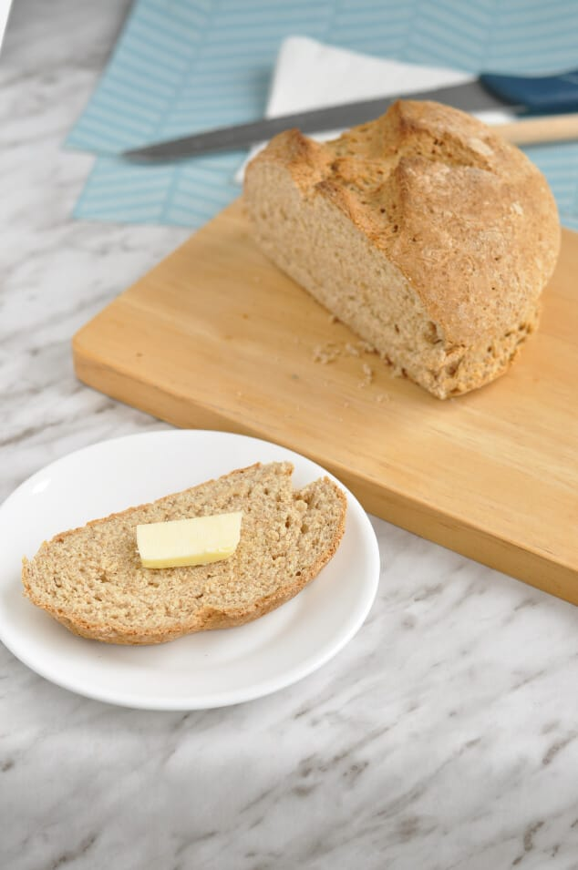 A slice of easy Irish soda bread with a piece of butter.