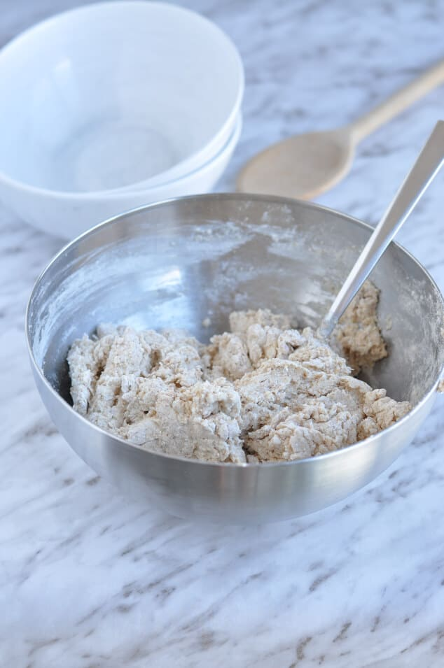 A silver bowl filled with the ingredients to make easy Irish soda bread.