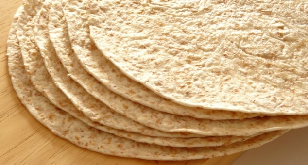 Easy Vegan Whole Wheat Tortillas Recipe - these soft whole wheat tortillas take just 1 hour to make and only require three simple ingredients! They're pretty healthy and much better for you than the ones you get in the store. I'll never buy tortillas ever again!
