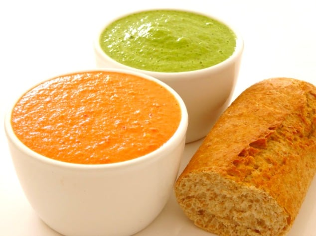 Red and green mojo sauces with a whole wheat baguette