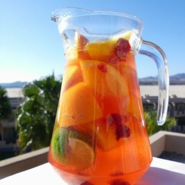 Raspberry Tequila Sparkler recipe - a fruity cocktail jug made of citrus fruits, raspberries, tequila and sparkling wine. Perfect for sipping by the pool this spring or summer!   www.happyhealthymotivated.com
