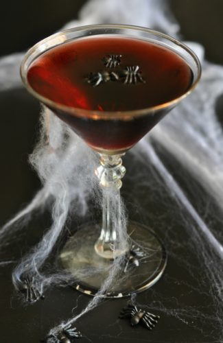 Looking for a spooky Halloween cocktail recipe that's easy to make and tastes delicious? This is it! This Black Widow Cocktail is made from just 4 simple ingredients and is perfect for sipping on a chilly fall night or for serving to a crowd for a Halloween party.