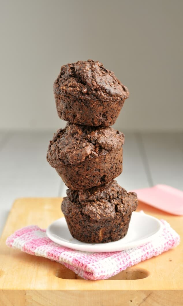 Three healthy double chocolate bran muffins stacked in a tower