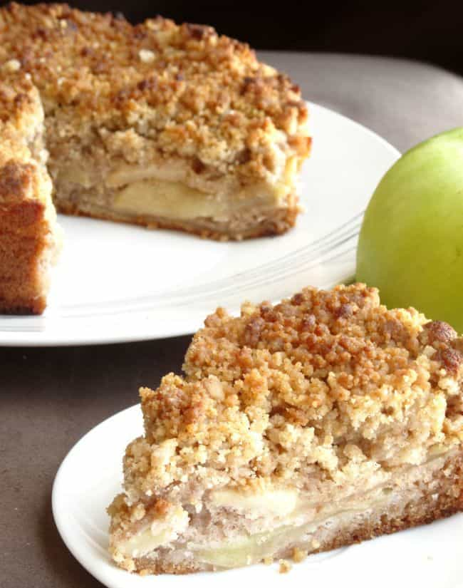 Apple Crumble Cake Recipe - a wonderful fall dessert made of a cinnamon sponge layer, thinly sliced apples and a wonderful buttery cinnamon crumb topping.   www.happyhealthymotivated.com
