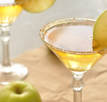 Two caramel apple martinis in martini glasses