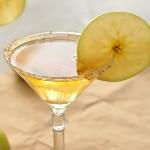 Close-up shot of a golden caramel apple martini