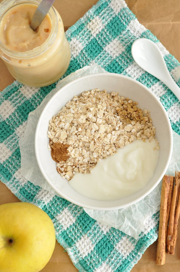The ingredients for caramel apple pie overnight oats in a bowl