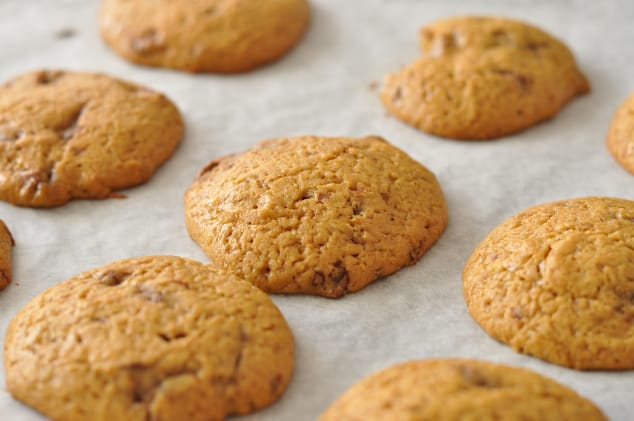 A tray of Healthy Pumpkin Cookies with Chocolate Chips on a lined baking tray