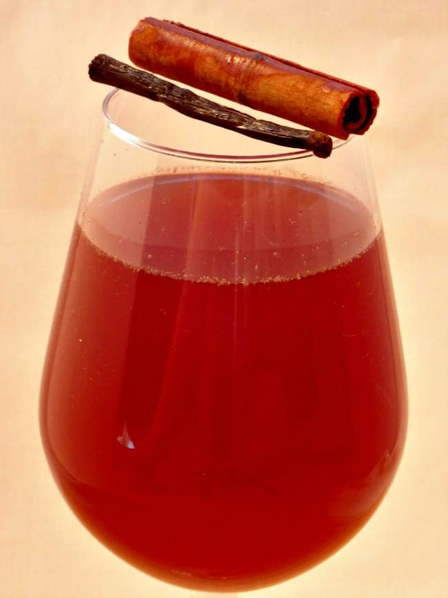 Mulled Rose Wine Recipe - did you know that you don't have to stick to a bottle of red to make mulled wine? You can make a deliciously festive mulled wine with a bottle of rose! This special Christmas drink is so easy to make and makes your house smell wonderful!   www.happyhealthymotivated.com