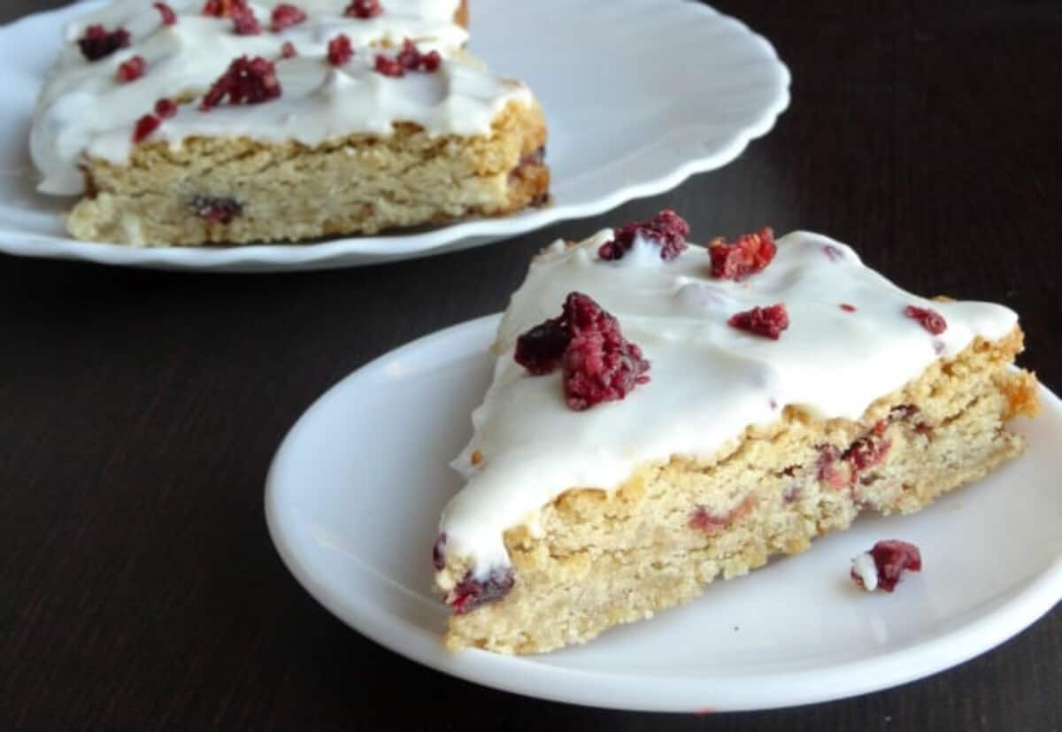 A slice of a White Chocolate Cranberry Blondie on a white plate.