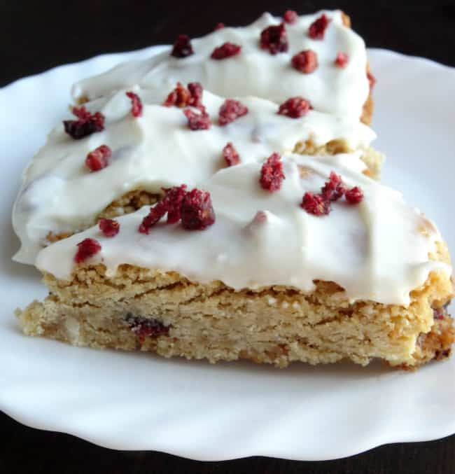 Skinny Starbucks Cranberry Bliss Bars Copycat Recipe - Save $$$ and loads of calories by making this healthier version of the coffee shop classic at home! Definitely one to have on your Christmas baking list every year. | www.happyhealthymotivated.com