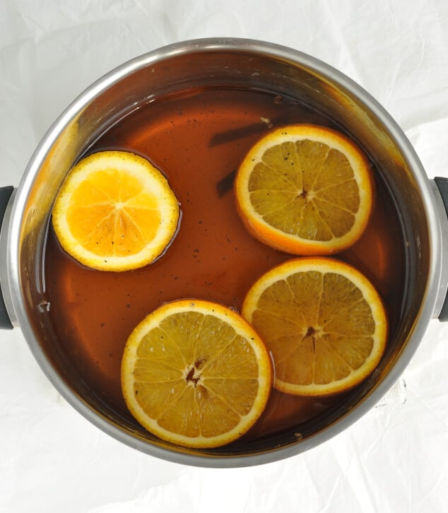 Saucepan filled with wine and orange slices