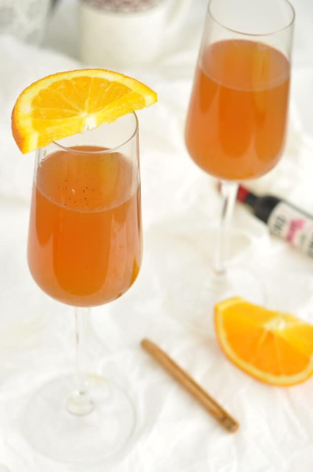 Two glasses of mulled white wine with orange segments