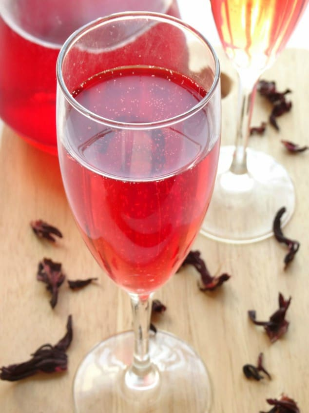 Champagne flute filled with sparkling hibiscus cocktail