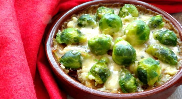 Lighter Brussels Sprouts Gratin Recipe - looking for a healthy Christmas side dish to help keep it light this year? These brussels sprouts au gratin is perfect! Crispy pan-fried brussels sprouts baked with ooey-gooey melted cheese. Heaven! | www.happyhealthymotivated.com