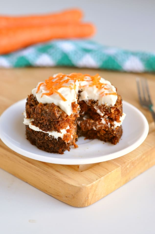 Healthy carrot cake mug cake with a slice taken out of it