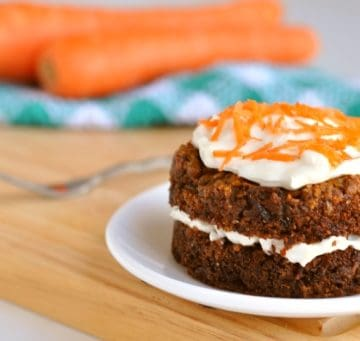 Healthy carrot cake mug cake with carrots in the background