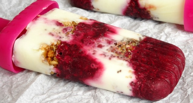 This healthy breakfast popsicle recipe is amazing! Each one is packed full of creamy Greek yogurt, sweet berries and crunchy granola. Perfect for a quick and easy summer breakfast on the go.