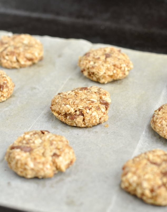 Raw healthy chocolate chip oatmeal cookie dough on a baking tray