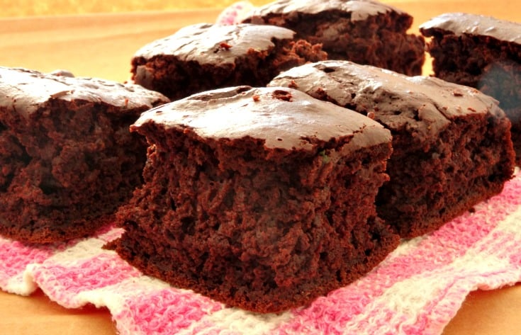 These healthy brownies have just 100 calories each! The recipe is super quick easy to follow and you've probably got all the ingredients in your cupboard right now. Applesauce helps lower the fat and sugar content and makes these brownies super fudgy. Yum!