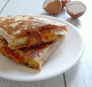 Easy Breakfast Quesadilla Recipe. A really fast and simple breakfast quesadilla loaded with smoky bacon, a soft fried egg and melted cheddar cheese. It comes together in just 10 minutes so you can even make it on a weekday morning! Don't have time to make it before work or school? Save it and have it as breakfast for dinner instead!