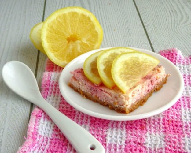 Healthy Lemon Raspberry Cheesecake Bars Recipe. This healthy dessert recipe is so summery and amazing! The base is a real buttery graham cracker crust and the filling is smooth, creamy and delicious. Just like a real cheesecake, but without all the fat, sugar and calories!