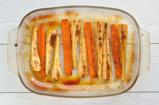 Honey roasted carrots and parsnips in a baking tray