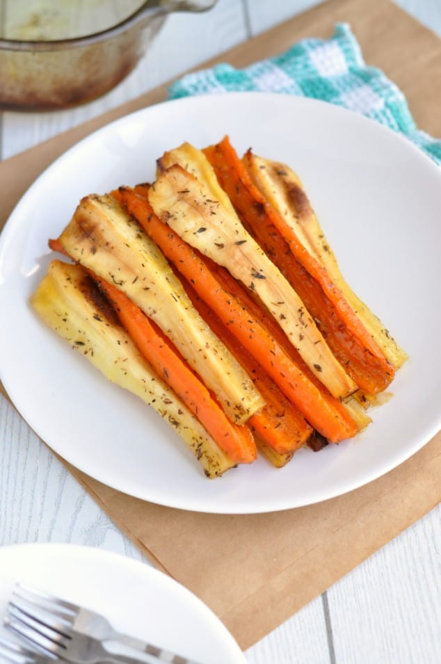 The Most Amazing Honey Roasted Carrots and Parsnips on a white plate as seen from above