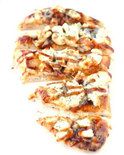 BBQ Chicken Naan Bread Pizza Healthy Version | Think pizza can't be healthy? Wrong! This recipe uses a yummy garlic naan bread as a pizza crust and is topped with protein-packed chicken, mozzarella and BBQ sauce.