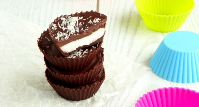 Coconut Chocolate Candy Cups Recipe | These bite-size treats are my favorite healthy summer snack ever! They're quick, easy and cheap to make and taste like gourmet candy! I always make a big batch at the start of summer so I know I've got enough to last.