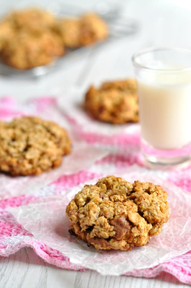 Closeup of low FODMAP chocolate chip cookies with a glass of milk