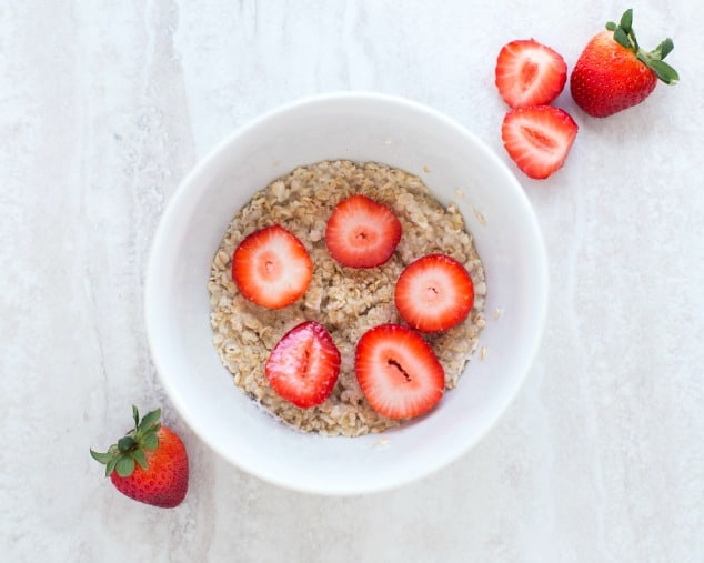 Bowl of oatmeal topped with strawberries