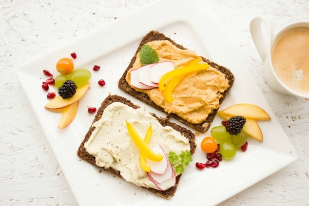 Two toasts with colorful toppings