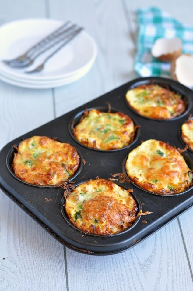 Healthy hash brown egg cups in a black muffin tin