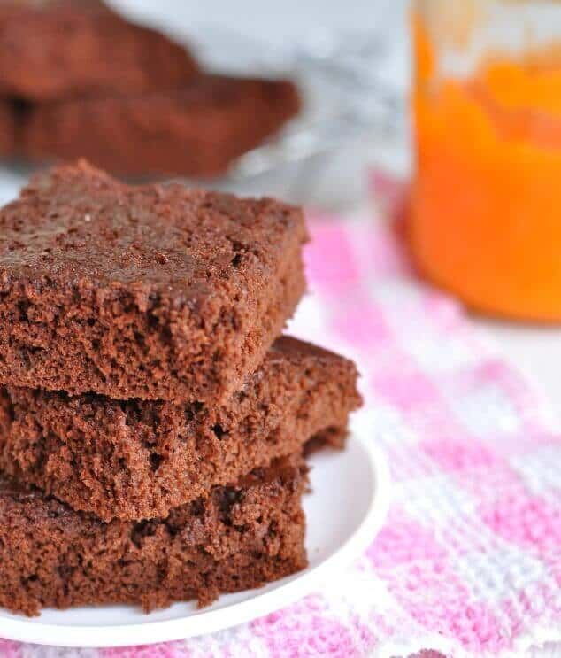 side view of healthy pumpkin brownies stacked on a plate