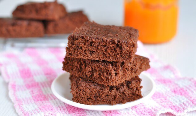 healthy pumpkin brownies on a plate with pumpkin puree in the background