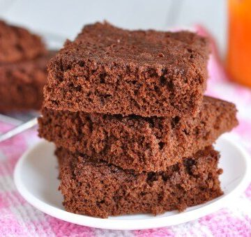 3 healthy pumpkin brownies stacked in a tower on a plate