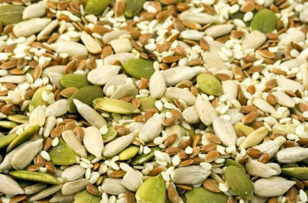 Colourful mixture of seeds that are low FODMAP foods