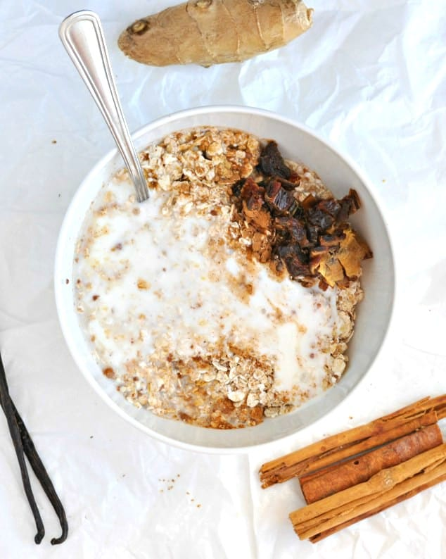 Healthy Gingerbread Overnight Oats with all the ingredients ready to be stirred in