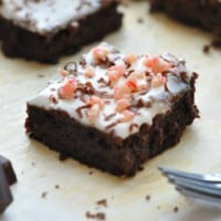 One healthy peppermint brownie surrounded by leftover crumbs