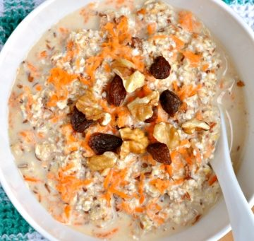 A bowl of carrot cake overnight oats on a green napkin