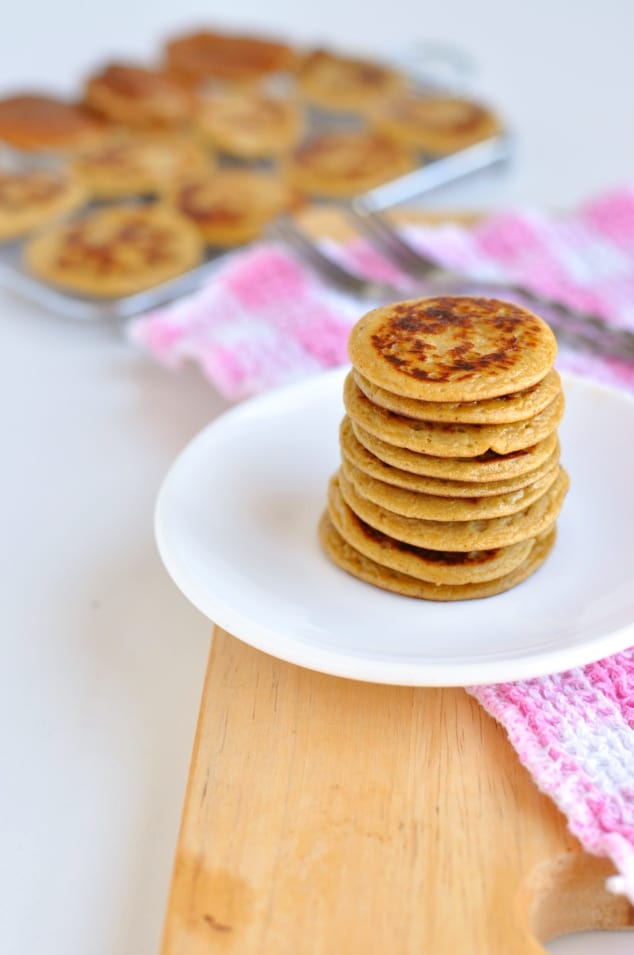 A stack of Healthy Peanut Butter Banana Pancakes with a tray of them in the background