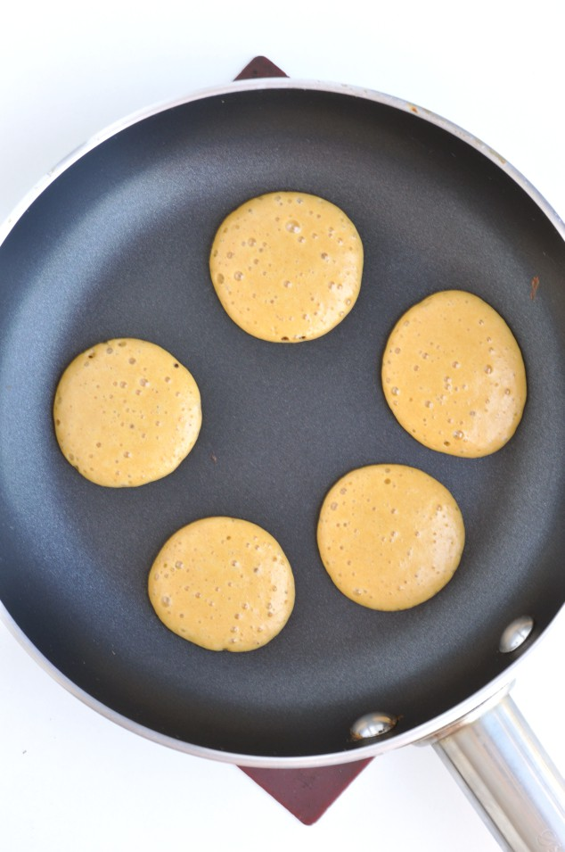Healthy Peanut Butter Banana Pancakes cooking in a pan